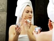 Woman using anti aging cream